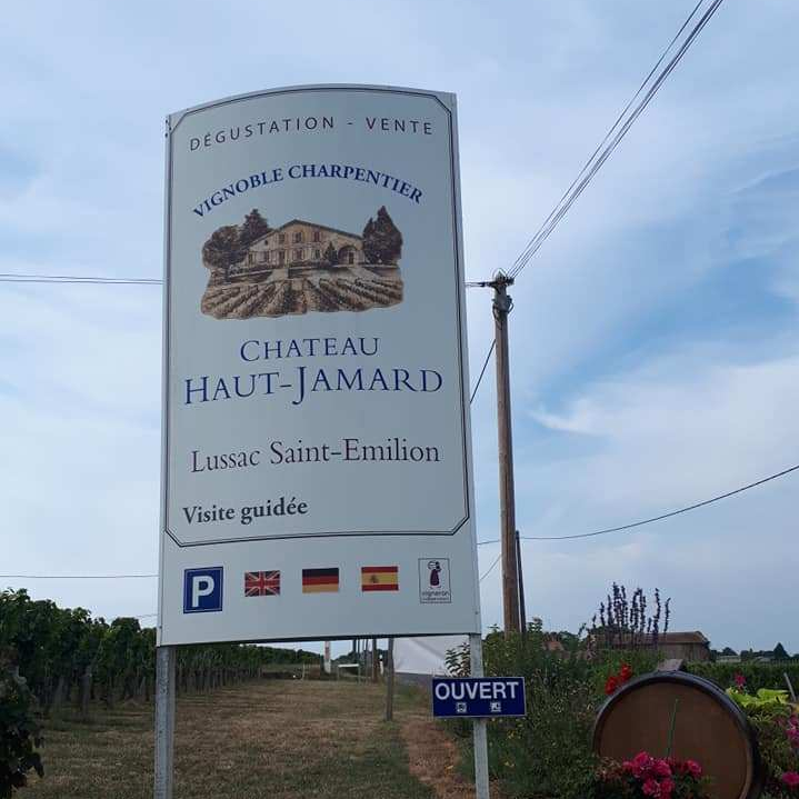 A sign for the vineyard